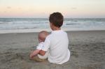 Small children posing for family beach portraits.